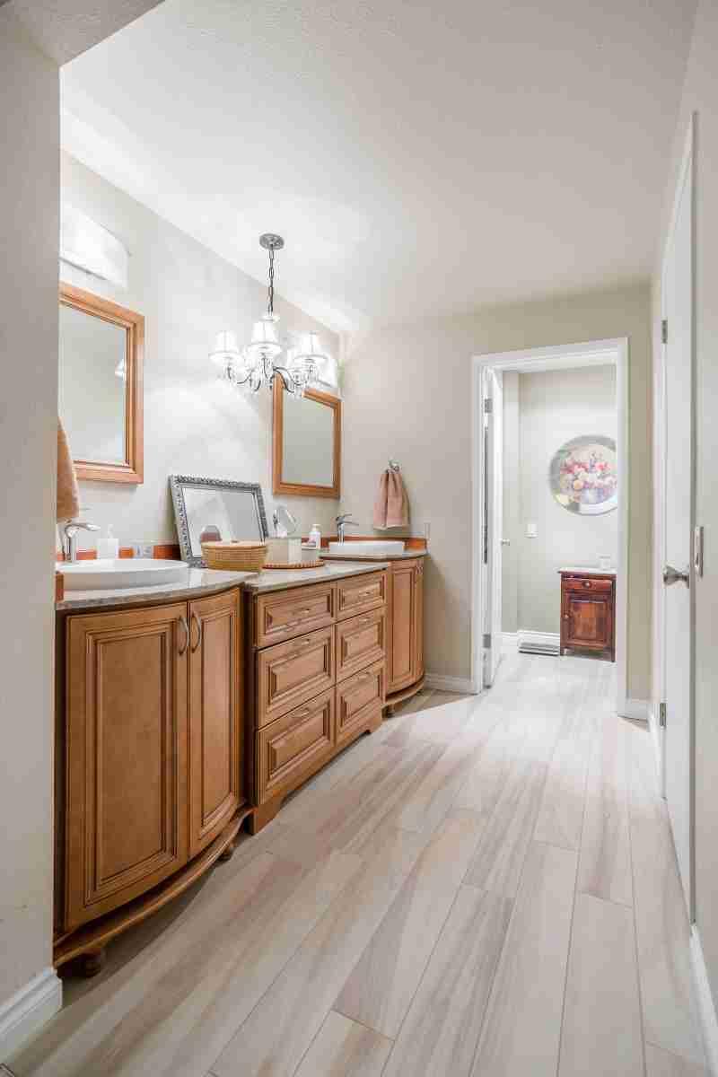 J&K Cabinetry Cinnamon Glazed Cabinet in Bathroom
