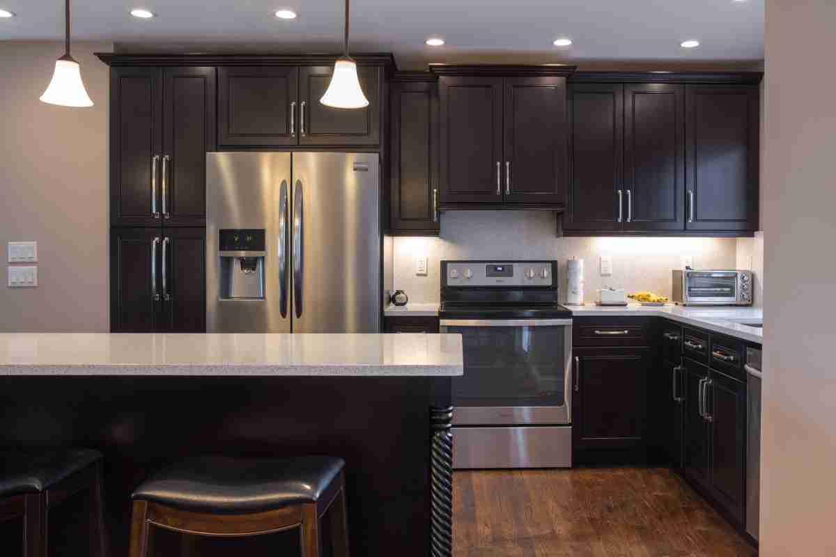 J&K Cabinetry Espresso Kitchen Cabinets with Granite