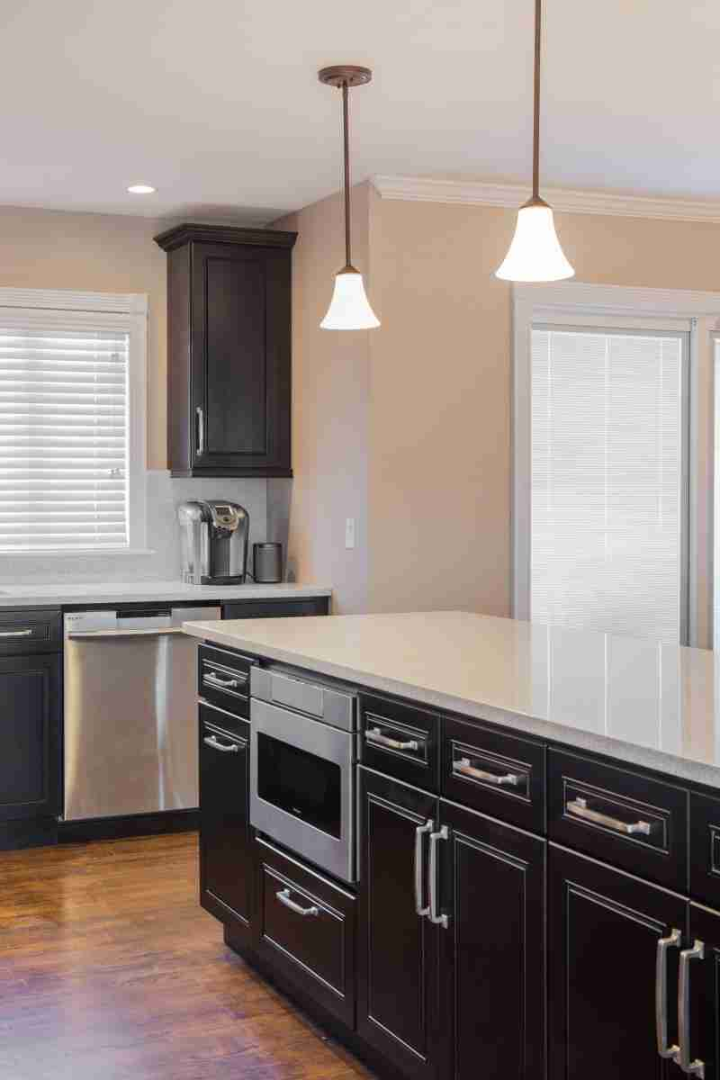 J&K Cabinetry Espresso Kitchen Cabinets with White Granite