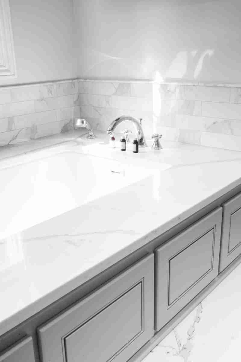 J&K Cabinetry Greige Bathroom Granite